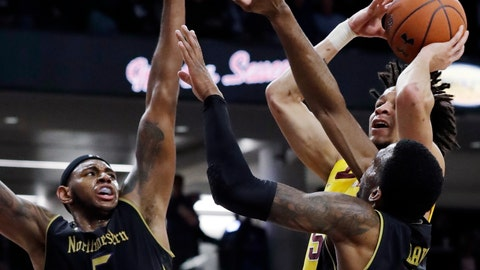 <p>               Minnesota guard Amir Coffey, top right, shoots against Northwestern center Dererk Pardon, left, and forward Vic Law during the first half of an NCAA college basketball game Thursday, Feb. 28, 2019, in Evanston, Ill. (AP Photo/Nam Y. Huh)             </p>