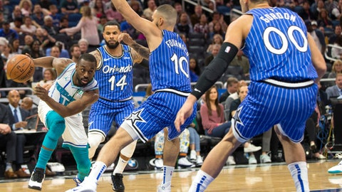 <p>               Charlotte Hornets guard Kemba Walker (15) dribbles against Orlando Magic guard D.J. Augustin (14), guard Evan Fournier (10) and forward Aaron Gordon (00) during the first half of an NBA basketball game in Orlando, Fla., Thursday, Feb. 14, 2019. (AP Photo/Willie J. Allen Jr.)             </p>