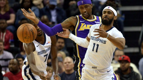 <p>               Memphis Grizzlies guard Mike Conley (11), Los Angeles Lakers guard Kentavious Caldwell-Pope, center, and Grizzlies forward Justin Holiday (7) struggle for control of the ball in the first half of an NBA basketball game Monday, Feb. 25, 2019, in Memphis, Tenn. (AP Photo/Brandon Dill)             </p>