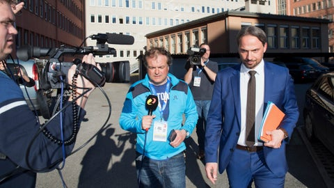 <p>               Dieter Csefan, right, of the Austrian police on his way back from the press conference about the doping raid at the Nordic World Ski Championships, in Innsbruck, Austria, on Wednesday, Feb. 27, 2019. (AP Photo/Kerstin Joensson)             </p>
