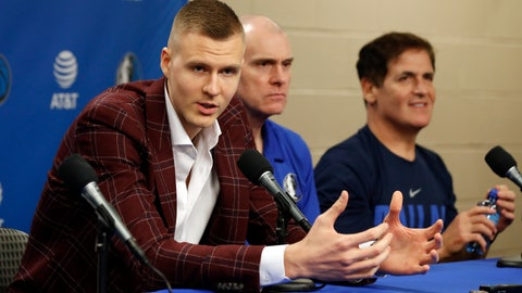 <p>               Newly acquired player Kristaps Porzingis, left, responds to questions as head coach Rick Carlisle, center, and team owner Mark Cuban, right, listen during a news conferences where the newly acquired players were introduced in Dallas, Monday, Feb. 4, 2019. (AP Photo/Tony Gutierrez)             </p>
