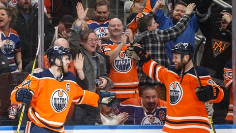 <p>               Edmonton Oilers' Connor McDavid (97) and Zack Kassian (44) celebrate a goal against the New York Islanders during the third period of an NHL hockey game Thursday, Feb. 21, 2019, in Edmonton, Alberta. (Jason Franson/The Canadian Press via AP)             </p>