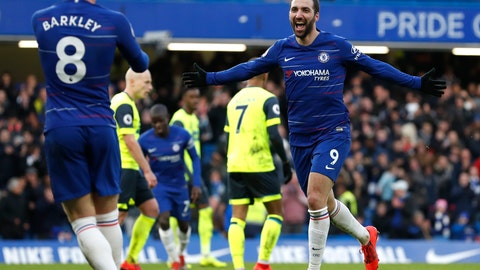 <p>               Chelsea's Gonzalo Higuain celebrates after scoring his side's fourth goal during the English Premier League soccer match between Chelsea and Huddersfield Town at Stamford Bridge stadium in London, Britain, Saturday, Feb. 2, 2019. (AP Photo/ Alastair Grant)             </p>