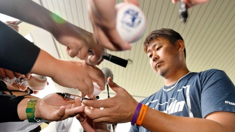 <p>               In this Feb. 9, 2019, photo, Chunichi Dragons pitcher Daisuke Matsuzaka gives his autographs for fans during spring training in Yomitan village in Okinawa, southern Japan. Matsuzaka is experiencing pain in his right shoulder after an overzealous fan pulled his throwing arm during a fan event at spring training. Matsuzaka was diagnosed with inflammation in his throwing arm as a result of the incident, and the Dragons on Tuesday, Feb. 12, 2019, told him not to throw for the time being. (Kyodo News via AP)             </p>