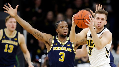 <p>               Iowa guard Jordan Bohannon grabs a loose ball in front of Michigan guard Zavier Simpson (3) during the first half of an NCAA college basketball game Friday, Feb. 1, 2019, in Iowa City, Iowa. (AP Photo/Charlie Neibergall)             </p>