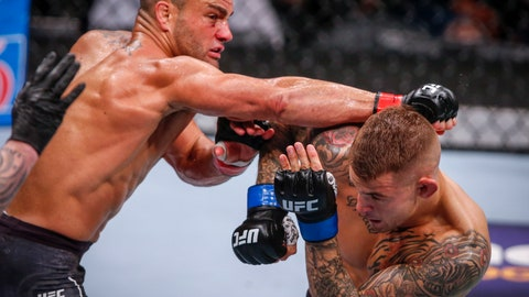 <p>               File-This July 28, 2018, file photo shows Eddie Alvarez, left, hitting Dustin Poirier during a lightweight mixed martial arts bout at UFC Fight Night in Calgary, Alberta. One Championship is venturing into UFC territory this week in an attempt to raise the U.S. profile of the Singapore-based mixed martial arts promotion. With a new Turner Sports broadcast deal and former UFC champs Demetrious Johnson and Alvarez leading a slew of new American signees, the Singapore outfit is touring the West Coast with its eye on the future. One doesn't have current plans for a North American show, but vice president Rich Franklin won't be surprised if it happens next year. (Jeff McIntosh/The Canadian Press via AP, File)             </p>