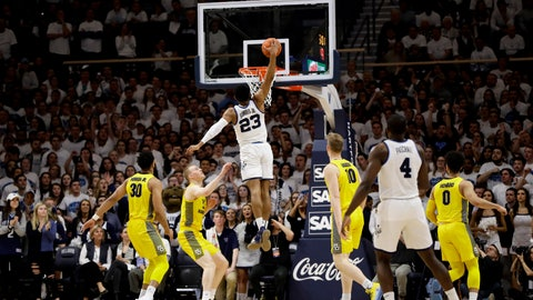 <p>               Villanova's Jermaine Samuels (23) goes up for a dunk between Marquette's Joey Hauser (22) and Sam Hauser (10) during the first half of an NCAA college basketball game, Wednesday, Feb. 27, 2019, in Villanova, Pa. (AP Photo/Matt Slocum)             </p>