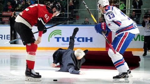 <p>               Former Manchester United coach Jose Mourinho, center, falls down after making the first puck drop at Monday's Kontinental Hockey League game between Avangard Omsk and SKA St. Petersburg in Moscow, Russia, Monday, Feb. 4, 2019. Former Manchester United coach has ceremonially opened an ice hockey game in Russia _ and promptly fallen on the ice. Two-time Stanley Cup winner Pavel Datsyuk of SKA St. Petersburg is on the right, Yevgeni Medvedev of Avangard Omsk is on the left. (AP Photo/Dmitry Golubovich)             </p>