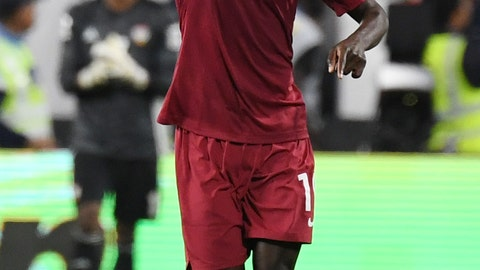 <p>               Qatar's forward Almoez Ali celebrates after scoring his side's second goal during the AFC Asian Cup semifinal soccer match between United Arab Emirates and Qatar at Mohammed Bin Zayed Stadium in Abu Dhabi, United Arab Emirates, Tuesday, Jan. 29, 2019. (AP Photo/Hassan Ammar)             </p>