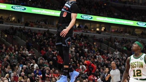 <p>               Chicago Bulls guard Zach LaVine (8) goes up for a dunk as Boston Celtics guard Terry Rozier (12) stands nearby during the first half of an NBA basketball game Saturday, Feb. 23, 2019, in Chicago. (AP Photo/David Banks)             </p>