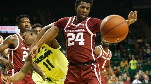 <p>               Oklahoma guard Jamal Bieniemy, right, pushes out Baylor guard Mark Vital, left, while pulling in a loose ball in the first half of an NCAA college basketball game, Monday, Feb. 11, 2019, in Waco, Texas. (Jose Yau/Waco Tribune-Herald via AP)             </p>