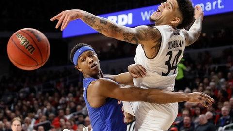 <p>               Cincinnati's Jarron Cumberland (34) and SMU's William Douglas, left, vie for a loose ball during the first half of an NCAA college basketball game Saturday, Feb. 2, 2019, in Cincinnati. (AP Photo/John Minchillo)             </p>