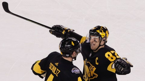 <p>               Pittsburgh Penguins' Sidney Crosby (87) celebrates with Justin Schultz (4), who scored against the Philadelphia Flyers during the second period of an NHL Stadium Series hockey game at Lincoln Financial Field, Saturday, Feb. 23, 2019, in Philadelphia. (AP Photo/Matt Rourke)             </p>