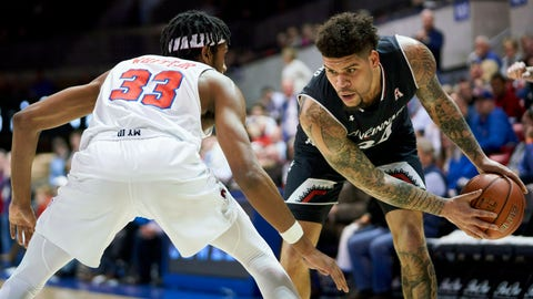 <p>               Cincinnati guard Jarron Cumberland (34) brings the ball up court against SMU's Jimmy Whitt Jr. (33) during the first half of an NCAA college basketball game at Moody Coliseum, Wednesday, Feb. 27, 2019, in Dallas. (AP Photo/Cooper Neill)             </p>