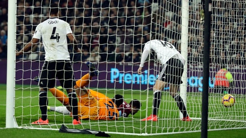 <p>               West Ham's Chicaharito, second right, scores his side's opening goal during the English Premier League soccer match between West Ham and Fulham at the London Stadium in London, Friday, Feb. 22, 2019. (AP Photo/Matt Dunham)             </p>