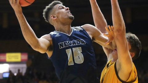 <p>               Nevada forward Trey Porter (15) shoots over Wyoming forward Hunter Thompson during the first half of an NCAA college basketball game Saturday, Feb. 16, 2019, in Laramie, Wyo. (AP Photo/Jacob Byk)             </p>