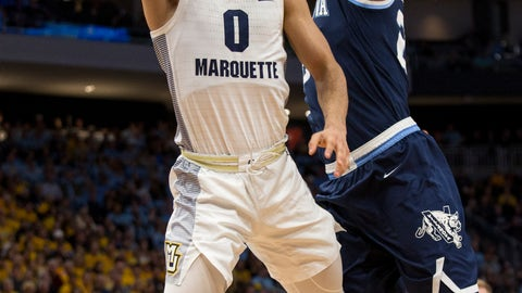 <p>               Marquette guard Markus Howard, left, goes up for a basket against Villanova during the first half of an NCAA college basketball game Saturday, Feb. 9, 2019, in Milwaukee. (AP Photo/Darren Hauck)             </p>