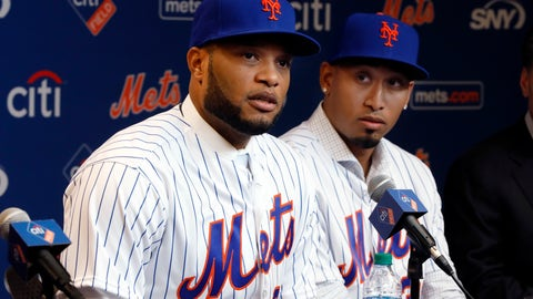 <p>               FILE - In this Dec. 4, 2018, file photo, Robinson Cano, left, and Edwin Diaz participate in a news conference at CitiField, in New York. In a flurry of offseason moves that began with a blockbuster trade with Seattle, the Mets added second baseman Cano, closer Diaz, catcher Wilson Ramos and infielder Jed Lowrie. (AP Photo/Richard Drew, File)             </p>