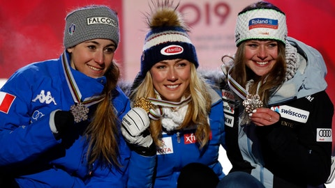 <p>               United States' Mikaela Shiffrin, center, shows her gold medal of the women's super-G, flanked by silver medallist Italy's Sofia Goggia, left, and bronze medal's Switzerland's Corinne Suter, at the alpine ski World Championships in Are, Sweden, Tuesday, Feb. 5, 2019. (AP Photo/Gabriele Facciotti)             </p>