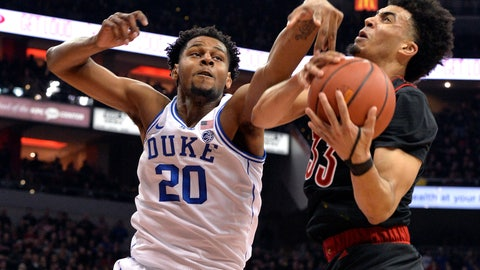 <p>               Duke center Marques Bolden (20) and Louisville forward Jordan Nwora (33) vie for a rebound during the first half of an NCAA college basketball game in Louisville, Ky., Tuesday, Feb. 12, 2019. (AP Photo/Timothy D. Easley)             </p>