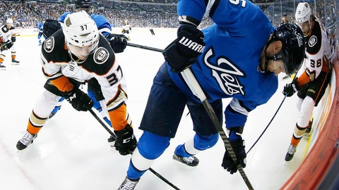 <p>               Winnipeg Jets' Dmitry Kulikov (5) digs for the puck against Anaheim Ducks' Nick Ritchie (37) and Derek Grant (38) during the first period of an NHL hockey game Saturday, Feb. 2, 2019, in Winnipeg, Manitoba. (John Woods/The Canadian Press via AP)             </p>