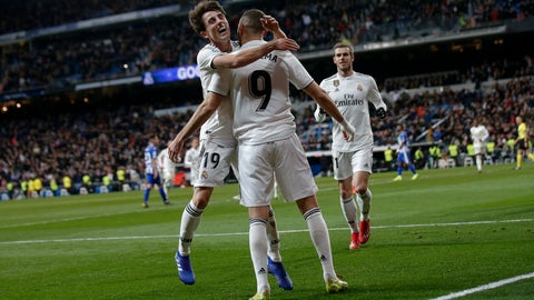 <p>               Real Madrid's Karim Benzema, center, celebrates his goal with his teammates Alvaro Odriozola and Gareth Bale, right, during a La Liga soccer match between Real Madrid and Deportivo Alaves at the Bernabeu stadium in Madrid, Spain, Sunday, Feb. 3, 2019. (AP Photo/Andrea Comas)             </p>