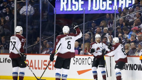 <p>               Colorado Avalanche's Ryan Graves (27), Erik Johnson (6), J.T. Compher (37) and Matt Nieto (83) celebrate Compher's goal against the Winnipeg Jets during second-period NHL game action in Winnipeg, Manitoba, Thursday, Feb. 14, 2019. (John Woods/The Canadian Press via AP)             </p>