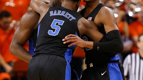 <p>               Duke's Zion Williamson, left, RJ Barrett (5) and Cam Reddish celebrate the team's 81-71 victory over Virginia during an NCAA college basketball game in Charlottesville, Va., Saturday, Feb. 9, 2019. (Mark Gormus/Richmond Times-Dispatch via AP)             </p>