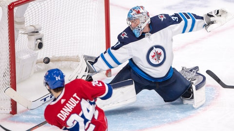 <p>               Montreal Canadiens center Phillip Danault (24) scores the fourth goal against Winnipeg Jets goaltender Connor Hellebuyck (37) during third-period NHL hockey game action Thursday, Feb. 7, 2019, in Montreal. (Ryan Remiorz/The Canadian Press via AP)             </p>