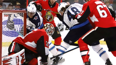 <p>               Ottawa Senators goaltender Anders Nilsson (31) smothers the puck as Winnipeg Jets centre Andrew Copp (9) and left wing Brendan Lemieux (48) dig for a loose puck during second period NHL hockey action in Ottawa, Ontario, on Saturday, Feb. 9, 2019. (Fred Chartrand/The Canadian Press via AP)             </p>