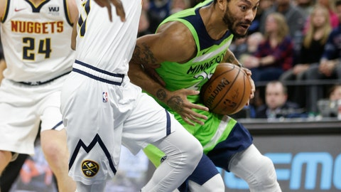 <p>               Minnesota Timberwolves guard Derrick Rose (25) drives around Denver Nuggets guard Monte Morris (11) during the first half of an NBA basketball game Saturday, Feb. 2, 2019, in Minneapolis. (AP Photo/Paul Battaglia)             </p>