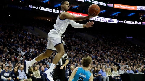 <p>               Villanova's Phil Booth, left, goes up for a shot over Georgetown's Mac McClung during the first half of an NCAA college basketball game, Sunday, Feb. 3, 2019, in Philadelphia. (AP Photo/Matt Slocum)             </p>