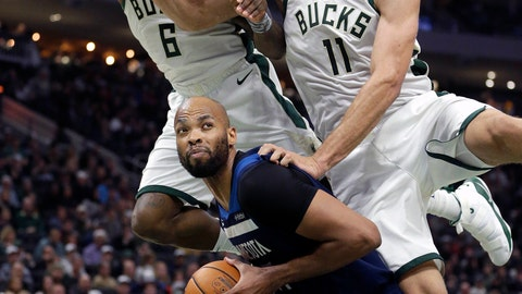 <p>               Minnesota Timberwolves' Taj Gibson, bottom, is fouled on a shot-attempt while defended by Milwaukee Bucks' Brook Lopez (11) and Eric Bledsoe (6) during the first half of an NBA basketball game Saturday, Feb. 23, 2019, in Milwaukee. (AP Photo/Aaron Gash)             </p>