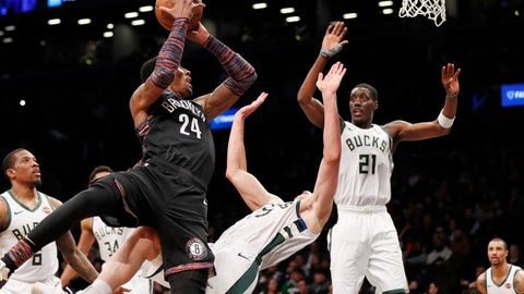 <p>               Brooklyn Nets forward Rondae Hollis-Jefferson (24) sends Milwaukee Bucks forward Ersan Ilyasova (77) flying to the floor as he goes up for a layup during the first half of an NBA basketball game, Monday, Feb. 4, 2019, in New York. Bucks guard Tony Snell (21) reacts, right. (AP Photo/Kathy Willens)             </p>