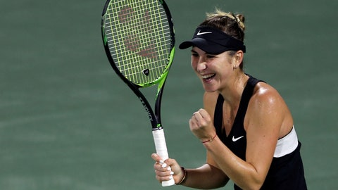 <p>               Switzerland's Belinda Bencic celebrates after defeating Romania's Simona Halep in their quarterfinal match of the Dubai Duty Free Tennis Championship in Dubai, United Arab Emirates, Thursday, Feb. 21, 2019. (AP Photo/Kamran Jebreili)             </p>