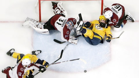 <p>               Nashville Predators left wing Filip Forsberg, top center, of Sweden, slides past the net between Colorado Avalanche goaltender Philipp Grubauer (31), of Germany, and defenseman Nikita Zadorov (16), of Russia, during the first period of an NHL hockey game Saturday, Feb. 23, 2019, in Nashville, Tenn. (AP Photo/Mark Humphrey)             </p>