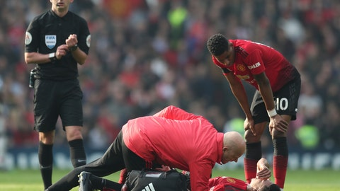 <p>               Manchester United's Jesse Lingard lays on the pitch after getting injured during the English Premier League soccer match between Manchester United and Liverpool at Old Trafford stadium in Manchester, England, Sunday, Feb. 24, 2019. (AP Photo/Jon Super)             </p>