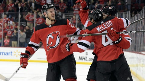<p>               New Jersey Devils center Kevin Rooney celebrates his short-handed goal with Michael McLeod (41) and Mirco Mueller, left, during the second period of an NHL hockey game against the Calgary Flames Wednesday, Feb. 27, 2019, in Newark, N.J. (AP Photo/Bill Kostroun)             </p>