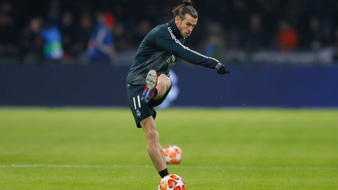 <p>               Real midfielder Gareth Bale shoots the ball as warming up during the first leg, round of sixteen, Champions League soccer match between Ajax and Real Madrid at the Johan Cruyff ArenA in Amsterdam, Netherlands, Wednesday Feb. 13, 2019. (AP Photo/Peter Dejong)             </p>