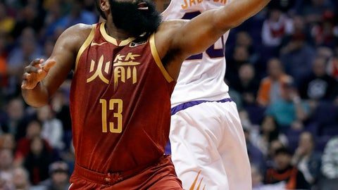 <p>               Houston Rockets guard James Harden (13) scores around Phoenix Suns forward Josh Jackson (20) during the first half of an NBA basketball game,, Monday, Feb. 4, 2019, in Phoenix. (AP Photo/Matt York)             </p>