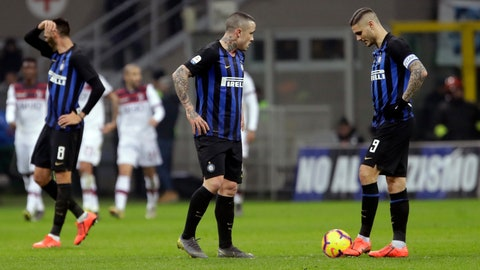 <p>               From left, Inter Milan's Matias Vecino , Radja Nainggolan and Mauro Icardi react after Bologna's Federico Santander scored during the Serie A soccer match between Inter Milan and Bologna, at the San Siro stadium in Milan, Italy, Sunday, Feb. 3, 2019. (AP Photo/Luca Bruno)             </p>