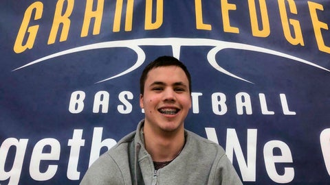 <p>               This photo provided by John Ellsworth shows Michael Bryant, Monday, Feb. 25, 2019 in Grand Ledge, Mich. Two Michigan high school basketball teams set rivalry aside during their last regular season game so Michael Bryant, a student team manager with cerebral palsy could fulfill his dream of playing after spending two seasons on the sidelines. (John Ellsworth via AP)             </p>