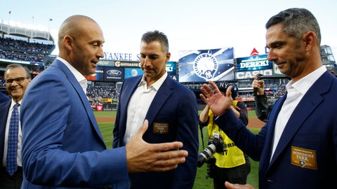 <p>               File-This May 14, 2017, file photo shows Rretired New York Yankees shortstop Derek Jeter, second from left, preparing to share hands with retired Yankees catcher Jorge Posada, far right, with another retired Yankee pitcher, Andy Pettitte, between them  during an on-field, pregame ceremony retiring Jeter's number 2 at Yankee Stadium in New York. A person with knowledge of the negotiations says Posada has agreed to team up with  Jeter again, this time in the front office of the Miami Marlins. The person says Posada will work as a special adviser to Jeter, his longtime New York Yankees teammate and now Marlins CEO. The person spoke to The Associated Press Tuesday, Feb. 12, 2019, on condition of anonymity because the hiring has not been formally announced. (AP Photo/Kathy Willens, File)             </p>