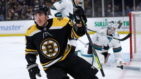 <p>               Boston Bruins left wing Brad Marchand, left, raises his stick after a goal against San Jose Sharks goaltender Martin Jones, right, during the second period of an NHL hockey game in Boston, Tuesday, Feb. 26, 2019. (AP Photo/Charles Krupa)             </p>