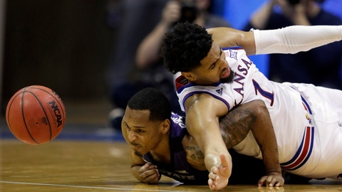 <p>               Kansas State guard Barry Brown Jr., left, and Kansas forward Dedric Lawson (1) dive for the ball during the second half of an NCAA college basketball game in Lawrence, Kan., Monday, Feb. 25, 2019. (AP Photo/Orlin Wagner)             </p>