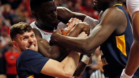 <p>               West Virginia's Chase Harler (14), Andrew Gordon (12) and Texas Tech's Norense Odiase (32) fight for control of the ball during the first half of an NCAA college basketball game Monday, Feb. 4, 2019, in Lubbock, Texas. (AP Photo/Brad Tollefson)             </p>