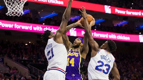 <p>               Los Angeles Lakers' Brandon Ingram, center, goes up for the shot against Philadelphia 76ers' Joel Embiid, left, of Cameroon, and Jimmy Butler, right, during the first half of an NBA basketball game, Sunday, Feb. 10, 2019, in Philadelphia. (AP Photo/Chris Szagola)             </p>