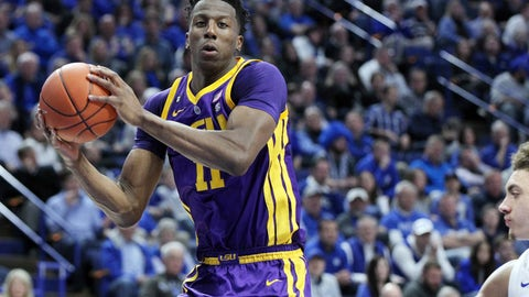 <p>               LSU's Kavell Bigby-Williams, left, pulls down a rebound near Kentucky's Reid Travis, right, during the first half of an NCAA college basketball game in Lexington, Ky., Tuesday, Feb. 12, 2019. (AP Photo/James Crisp)             </p>