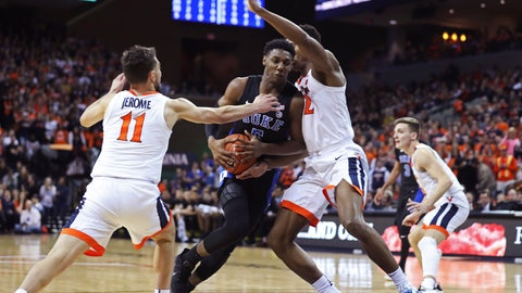 <p>               Duke forward RJ Barrett (5) splits two Virginia defenders during the first half of an NCAA college basketball game Saturday, Feb. 9, 2018, in Charlottesville, Va. (AP Photo/Zack Wajsgras)             </p>