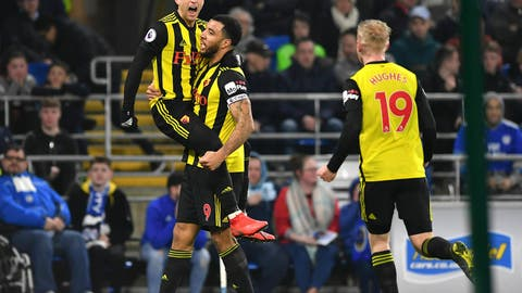 <p>               Watford's Gerard Deulofeu, left, celebrates scoring his side's second goal of the game with teammates Troy Deeney and Will Hughes, right, during the English Premier League soccer match between Cardiff City and Watford at the Cardiff City Stadium, Wales, Friday, Feb. 22, 2019. (Simon Galloway/PA via AP)             </p>